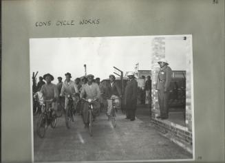 Workers arrive at a bicycle manufacturing plant in Springs